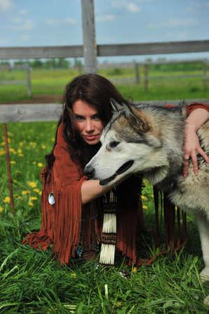 paiute: American Indian Woman near to Husky Stock Photo