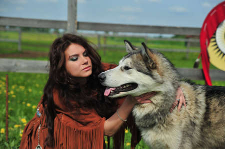 blue eye husky: American Indian Woman near to Husky Stock Photo