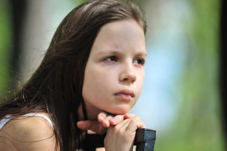 Portrait of the little girl with long hair looking aside Stock Photo - 7113389
