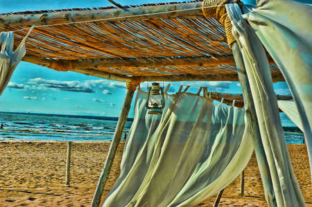 exterminating: Tent from by white fabric ashore exterminating Stock Photo