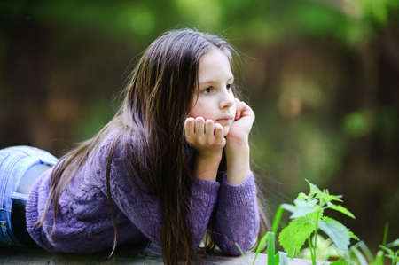 Portrait of the little girl with long hair looking aside Stock Photo - 7113403