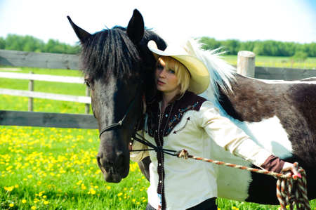 The girl the cowboy near to a horse Stock Photo - 7152822