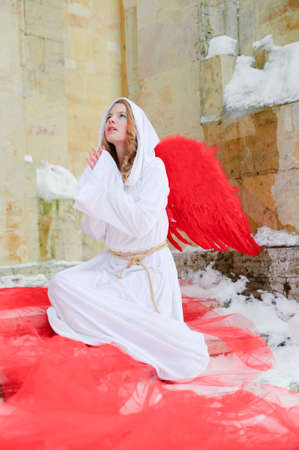 cassock: Beautiful young angel with red wings