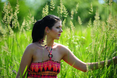 Young girl in high grass field photo