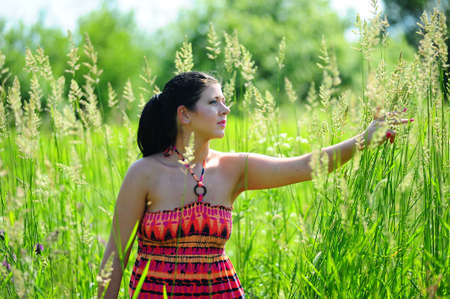 Young girl in high grass field Stock Photo - 7539515
