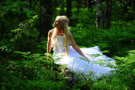 getting a bride: The fair-haired bride in wood on a clearing