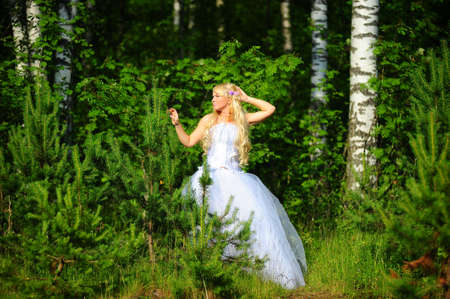 The fair-haired bride in wood on a clearing Stock Photo - 7314660
