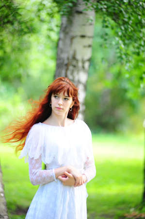 The girl with long red hair Stock Photo - 7557424