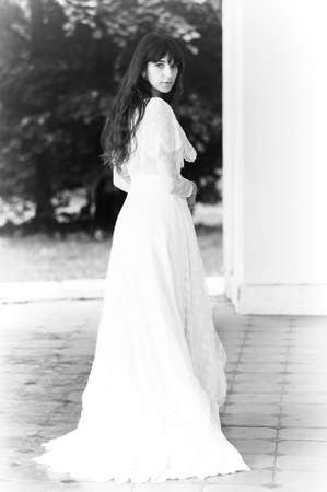 vintage mansion: Portrait of a beautiful young victorian lady in white dress Stock Photo