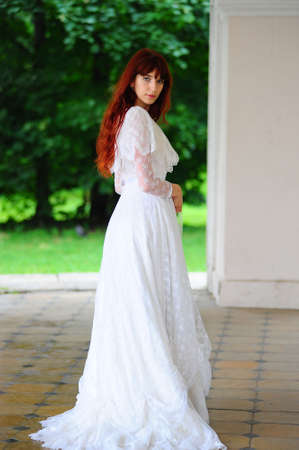 Portrait of a beautiful young victorian lady in white dress photo