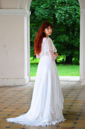 the historical: Portrait of a beautiful young victorian lady in white dress Stock Photo