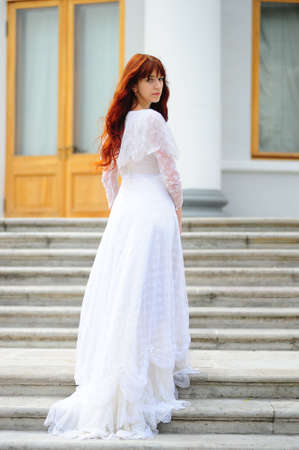 The leaving girl in a white dress photo
