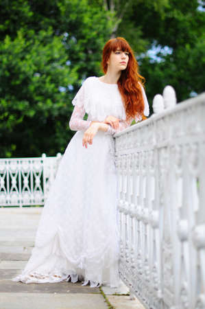 The girl on a balcony at a handrail photo
