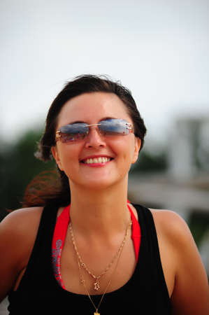 Happy brunette with glasses and pretty smile photo
