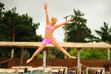 The girl jumping on a trampoline photo