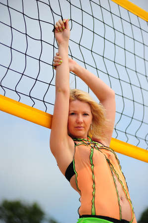Portrait of the girl near to a volleyball net photo