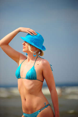 two piece bathing suit: The blonde in a blue bathing suit