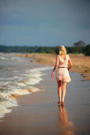 The girl leaving on beach coast photo