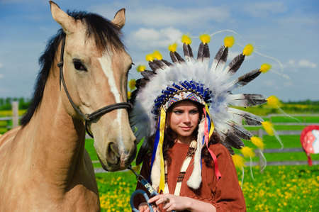 American Indian Girl petting her horse outside