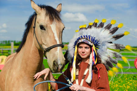 American Indian Girl petting her horse outside Stock Photo - 7563850