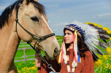native american woman: American Indian Girl petting her horse outside