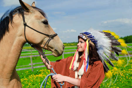 American Indian Girl petting her horse outside Stock Photo - 7563851