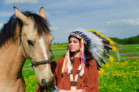 American Indian Girl petting her horse outside Stock Photo - 7563849