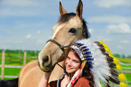 American Indian Girl petting her horse outside Stock Photo - 7563841