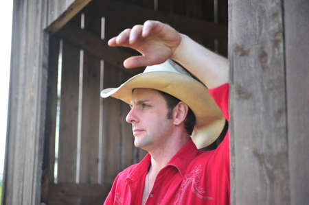 Portrait of a mid-adult Caucasian male wearing cowboy hat. Stock Photo - 7592304