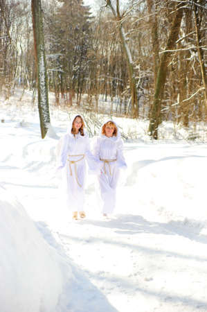 Two girls in suits of angels photo