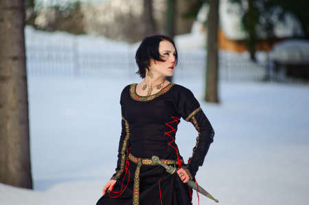 The girl in a medieval dress of the hunter Stock Photo - 7585413