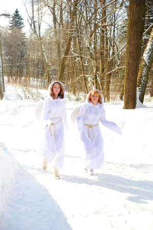 cassock: Two white angels Stock Photo
