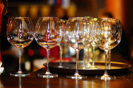 empty wine glasses on a brown background photo