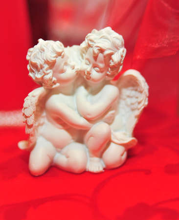 artificial model: Two embracing angels