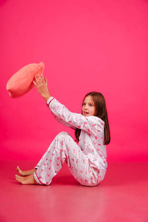 pranks: The girl in a pajamas throwing a pillow