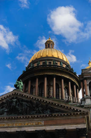 Dome of the Isakievsky cathedral against the blue sky with clouds photo