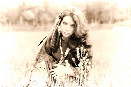native american girl: The girl in a suit of the American Indian. Photo executed in a retro style Stock Photo