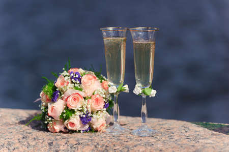 Bouquet of the bride and glasses with champagne Stock Photo - 8181264