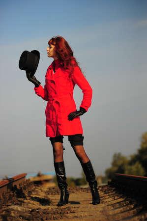 far away look: girl on the rails Stock Photo
