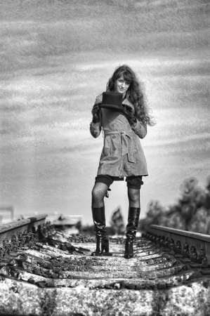 going nowhere: girl on the rails Stock Photo