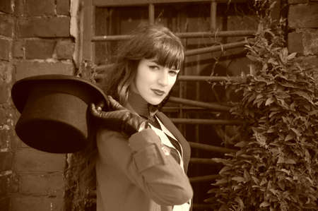 Beautiful young woman wearing a black cylinder hat photo