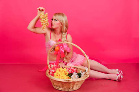 A blonde with a basket of fruit photo