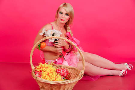 Blond on a pink background photo