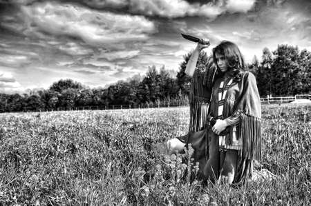girl dressed as an Indian with a knife in his hand photo