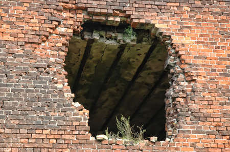 destroying: ruined brick house
