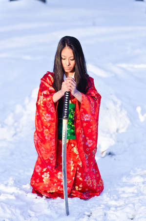 Young japanese woman with samurai sword photo