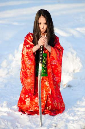 geisha kimono: Young japanese woman with samurai sword