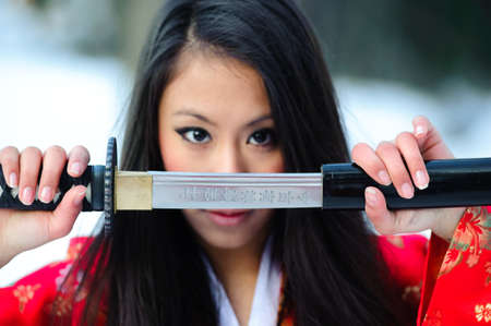 Young japanese woman with samurai sword fashion Stock Photo - 8349307