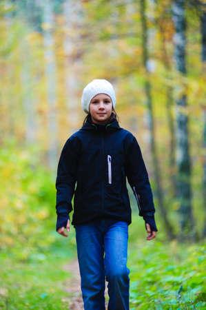 girl walking in autumn park photo