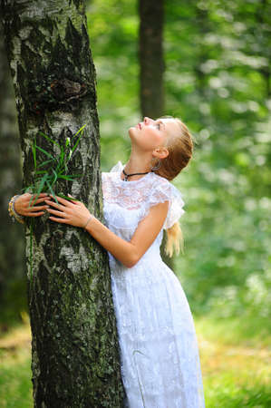 girl in white dress with birch photo